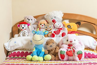 Cuddly toys on a bed