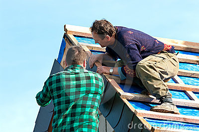 Two roofers at work