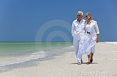 Happy Senior Couple Walking on A Tropical Beach