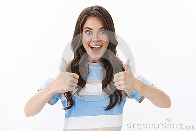 Ambitious upbeat good-looking modern woman looking satisfied, excited happily thumb-up approve awesome idea, smiling