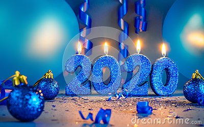 New years 2020 blue glitter candals with balloons and streamers