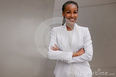 African american business woman smiling confidently, cheerful, accomplished, proud, successful, at financial workplace building