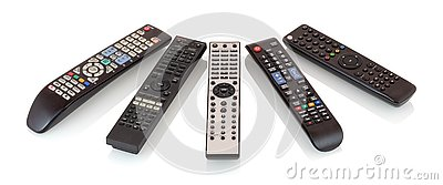 Bunch of remote controls for TV , Blu Ray player, satellite receiver, home cinema amplifier isolated on white background.