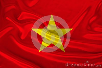 Photo of the national flag of Vietnam on a luxurious texture of satin, silk with waves, folds and highlights, close-up, copy space