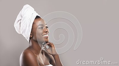 Beautiful african woman with towel on head and glowing skin