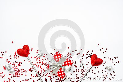 Two love magic wands and a gift. Valentine`s Day concept. Copy space