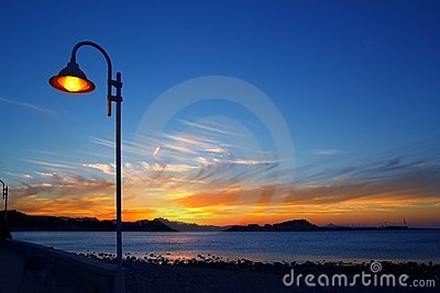 Sunset orange blue seascape light lamppost