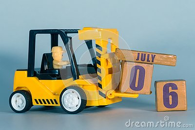 july 6th. Day 6 of month, Construction or warehouse calendar. Yellow toy forklift load wood cubes with date. Work planning and