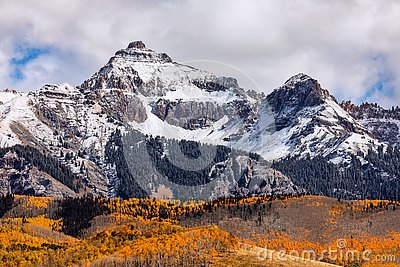 Autumn scene with snow and fall colors in the San Juan Mountains near Telluride, Colorado