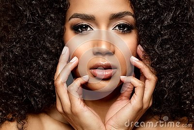 Beauty black skin woman African Ethnic female face. Young african american model with long afro hair. Lux model