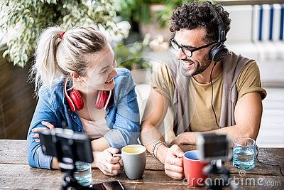 Young millenial couple sharing creative content online on webcam - Digital marketing concept with next generation influencer