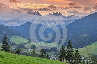 Amazing evening view of St. Magdalena village, Funes Valley Villnob with Odle Group mountains on background, Dolomiti Alps,