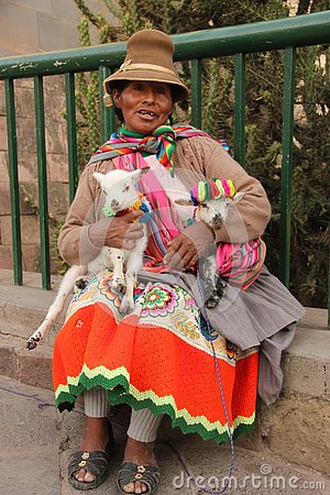A Peruvian woman and her goats