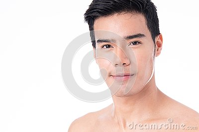 Portrait of Handsome young asian man isolated on white background. Concept of men`s health and beauty, self-care, body and skin