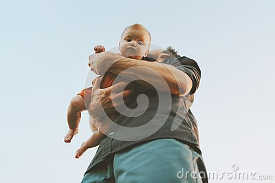 Father holding infant baby family lifestyle dad and child