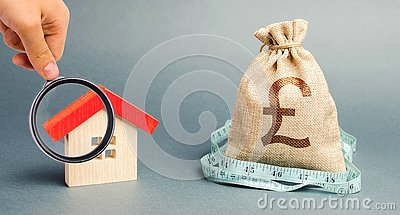 Bag with money and tape measure with a wooden house. Property valuation. Limited real estate budget. Low subsidies. Lack of