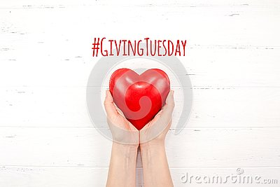 Giving Tuesday concept with red heart in hands