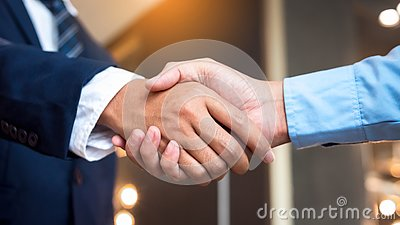 Close up businessmen shaking hands during a meeting. Handshake deal business corporate