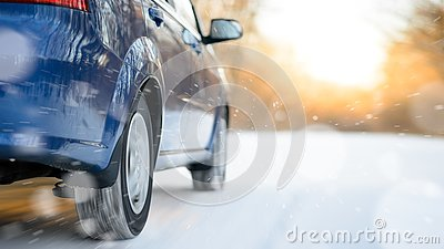 Blue Car Moving Fast on the Winter Snowy Road. Safe Driving Concept.