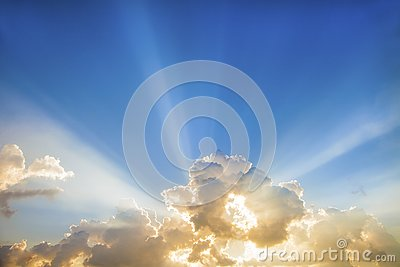 Sun rays with clouds on blue sky landscape.rays of light on the sky