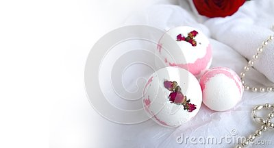Mockup bath bombs, towel, pearl and red rose on white background.