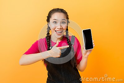 Pretty asian woman holding smartphone and pointing finger to the smartphone