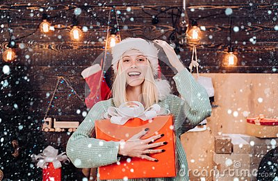 Christmas Girl - snow efects. Portrait of a young smiling woman. Holly jolly swag Christmas and noel. New year gift