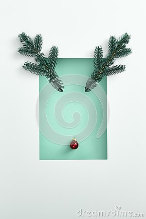 Reindeer face made of red xmas ball and evergreen branch with white border