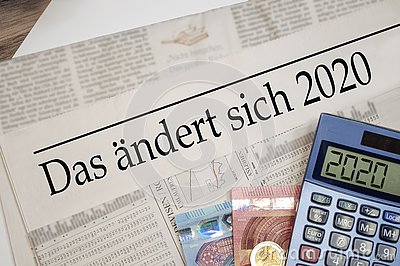 Newspaper with money and calculator and german headline Changes coming in 2020 - das ändert sich 2020