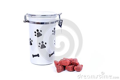 Grey doggy treat container with black pawprints and red meat snacks