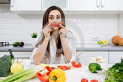 Sportive Brunette Posing With a Chili Pepper Moustache
