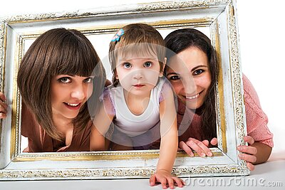 Two girls and child holding wooden white frame