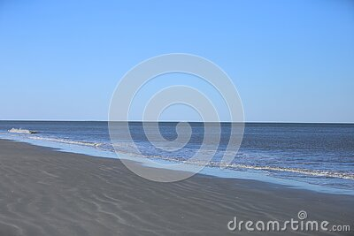 Blue skies and serene waves on Hilton Head Island, South Carolina sandy rippling beaches