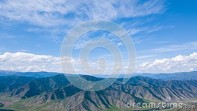 Panoramic wide banner view of a Chike-Taman pass in the Altai mountains with green trees, Blue sky and clouds