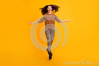 Full body photo of amazing funky lady jumping up high youth trend look throwing hairdo curls air wear fluffy sweater