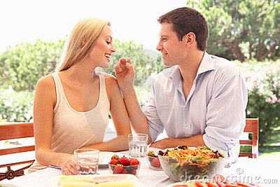 Young couple eating outdoors