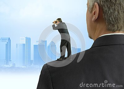 Man with binoculars looking into the distance standing on the shoulders of giants concept with cityscape background