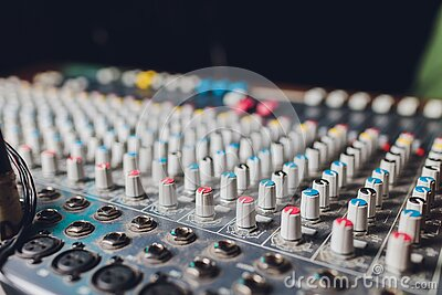 The mixer. remote for sound recording. sound engineer at work in the studio. sound amplifier mixing console equalizer