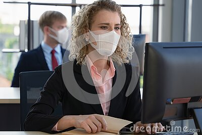 Caucasian businesspeople with medical mask for coronavirus covid-19 protection working in office