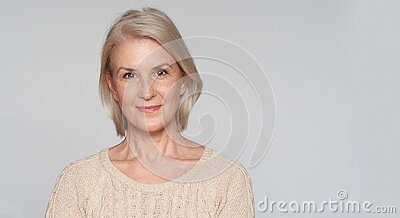 Portrait of beautiful senior woman smiling. 50 years old blonde lady