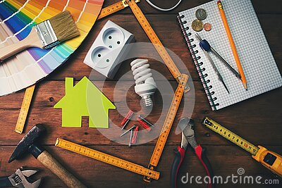 Home improvement and repair concept - work tools and objects on wooden table