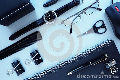 Men`s office supplies and accessories on a gray table.