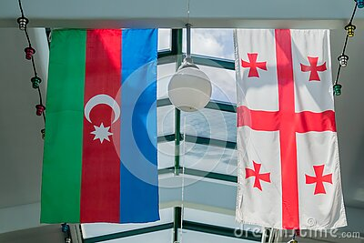 Flags of Georgia and Azerbaijan hanging on the ceiling
