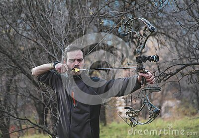 Archer shooting compound bow
