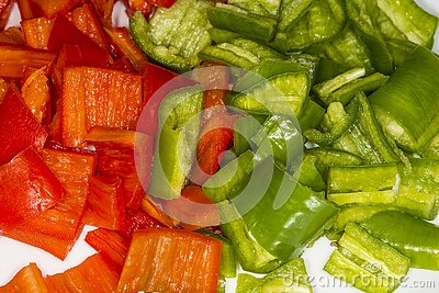 Red and green cut peppers, ready for roasting