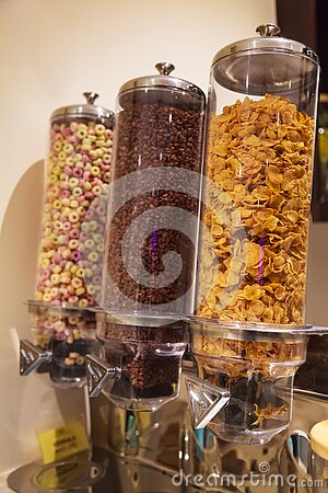 Selective Focused Variety of Breakfast Cereals Morning Meal; Crisp Dark Chocolate, Corn Flakes and Fruit Loops in Cereal Glass Jar