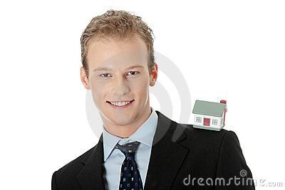 Young business man with house model