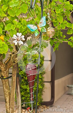 Humming bird feeder  at entrance to tropical residential home