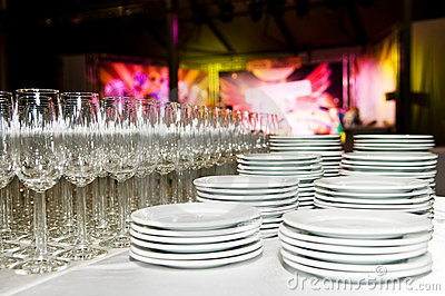 White plates and stemware glass at