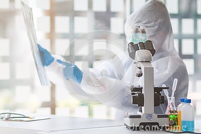 The medical team wore a coronavirus protective suit and rubber gloves to examine the coronavirus covid-19 and research for a